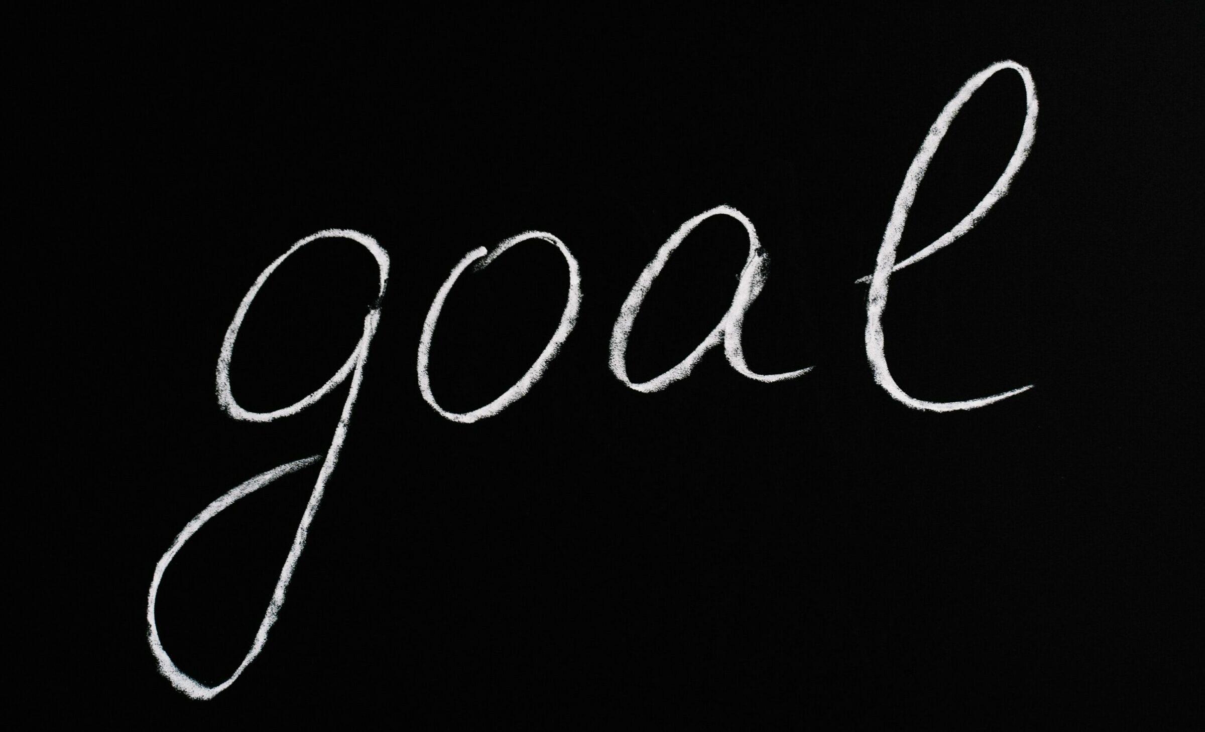 het woord 'goal' in krijt geschreven